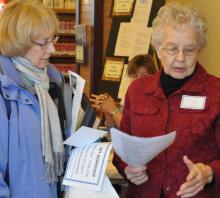 Volunteers explain library programs